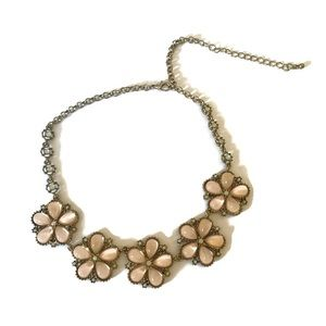 Pink flowers and gold tone statement necklace